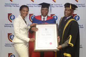 Dr Herman Mashaba (centre) is accompanied by his wife, Mrs Connie Mashaba